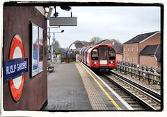 Gaily Into Ruislip Gardens / Runs The Red Electric Train (R~P~M) Tags: poem literary betjeman middlesex poetry ruislipgardens train railway station london ruilsip londonunderground centralline england uk unitedkingdom greatbritain