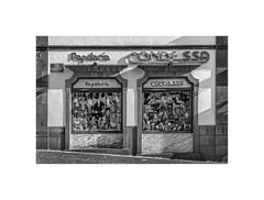 Papelaria Condessa (silver/halide) Tags: madeira funchal architecture shopfront johnbaker manualfocus mono blackandwhite bw festive papelariacondessa stationary store storefront shop