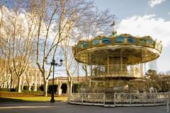 Merry-Go-Round between the Opera House and the Royal Palace (Madrid, Spain) (G.Roca) Tags: sunny winter roundabout photoshop empty ride royal lights longexposure bright carrusel spain palace travel outdoor opera afternoon outdoors madrid amusement tourism merrygoround carousel