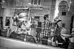 Blow-Dry (Hugh Rawson) Tags: streetphotograph hairdressers street reflection mono streetphotographer cambridge man urban monochrome woman barber streetphotography city blackandwhite bw hair