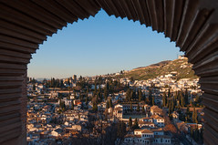 Albaicín View (Oliver J Davis Photography (ollygringo)) Tags: albaicín albayzín medieval moorish unescoworldheritagesite unesco worldheritagesite worldheritage history heritage travel spain españa andalusia andalucia window view frame framed vista panorama city hill cityscape alhambra islam islamic architecture culture nikon d90 cypress trees homes houses community