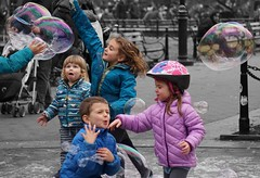 """""""We're so close To reaching that famous happy end Let's go on dreaming though we know we are So close So close And still so far"""" - Enchanted (Lidiya Nela) Tags: park manhattan urban nyc city newyorkcity newyork street streetphotography candid color bubbles children washingtonsquarepark partialcolor selectivecolor sony sonya6000"""