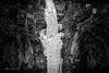 Frozen (Chris Lakoduk) Tags: waterfall frozen frozenwaterfall cliff rocks lavarocks lowercoulee grantcounty water blackandwhite blackandwhitephotography art ice icewater exploration explore