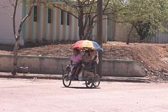 Border Crossing (becklectic) Tags: 2002 girls woman girl bike bicycle umbrella women border nicaragua umbrellas pedicab bordercrossing umbrellagirls views100 worldtrekker 01417290913