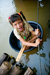 floating girl (phitar) Tags: girl cambodia 2006 tub float tonlesap phitar
