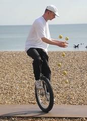 Tom James the unicycling juggler. . .