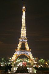 bright lights (flamed) Tags: paris france night eiffeltower parisian slowshutterspeed