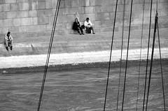 The silent invite (stevec77) Tags: girls blackandwhite bw man paris france water seine river spring sitting ropes printemps embankment z740 kodakz740 riveseine