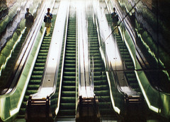 Escalators (bentilden) Tags: seattle usa man reflection green film wow tile washington transit escalators bustunnel