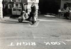 london (ten8photo) Tags: street city blackandwhite bw london vespa voigtlander streetphotography rangefinder roadtrip scooter top20street ten8photo top201 mobformat09filmstill mobformat09filmnoir mobformat11streetnoir