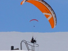 Landing (Zunkkis) Tags: blue winter sky orange white snow abstract man men wow painting skydiving grey fly flying skies landing parachute parachutes skypeople