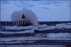 Surrounded by a Wave (Mrs. Terry) Tags: blue architecture mi lighthouses piers lakemichigan lanterns surrounded catwalk michiganlighthouse stjosephriver stjosephmi instantfave stormwaves over35 flickrific outerlighthouse