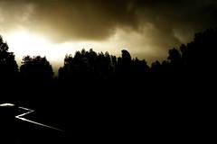 shadow and glare (Brenda Anderson) Tags: sky black rain silhouette clouds glare rainy curiouskiwi brendaanderson utata:color=black utata:project=justblack curiouskiwi:posted=2006