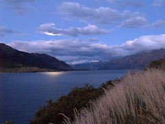 P4119623 (Sam's Exotic Travels) Tags: newzealand moon water night sam nz southisland westcoast sams travelphotos lakehawea zd 1445mm specnature samsays samsexotictravelphotos exotictravelphotos samsayscom