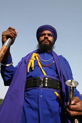 Young Nihang Singh, India (Captain Suresh Sharma) Tags: travel blue portrait india man heritage history beard religious costume belt bravo dress symbol martial traditional religion young culture rob weapon bracelet sword historical stick nomad turban sikh tradition punjab ethnic cultural singh khalsa headgear nomadic akali celibacy nihang specialattire