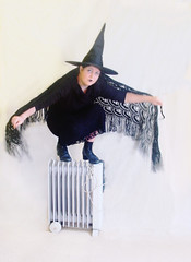 you won't burn this witch (Janet Leadbeater) Tags: black blur hat topv111 topv333 boots witch magic heater witchs batwings purge
