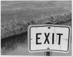 Exit (Green Apples) Tags: blackandwhite signs water 35mm exit