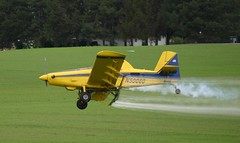 Crop Duster (Jenni Reynolds-Kebler) Tags: tractor field plane airplane fly flying air crop duster 100views 400views agriculture cropduster i500 airtractor