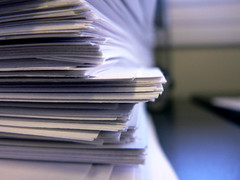 The Paperwork (>MacAddict<) Tags: white macro paper sheets paperclip