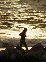 Pacing at Sunset (Sharon Mollerus) Tags: ocean california sunset sea beach girl golden surf waves shore pacifica 50v5f thecontinuum lovephotography