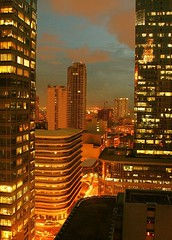 Yellow office view (Iron Goddess) Tags: city sky building yellow night skyscraper buildings corporate lights evening day cityscape view balcony chatham makati