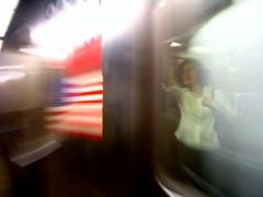 Friday evening commute (Vidiot) Tags: nyc columbus blur nycpb train circle subway calendar flag commute columbuscircle