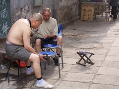 Hazard (milnikus) Tags: china people dice chinese beijing flipflops  hutong  stool playinggames slippers hazard peking  chinesepeople  beijingstreet hazardgames