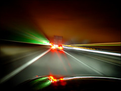 . Speed . (3amfromkyoto) Tags: road longexposure light motion blur car sign night speed truck lights drive movement motorway fast lorry passenger headlamp cambridgeshire whiteline headlamps a14 hardshoulder 3amfromkyoto cambridgenextleft flickr:user=3amfromkyoto