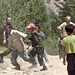 Aid workers play with Afghan kids