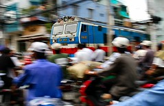 Train Crossing (J Catlett) Tags: street travel motion color train movement perfect asia seasia southeastasia crossing streetphotography vietnam passenger panning saigon hochiminhcity hcmc hochiminh traincrossing indochina passengertrain payitforward panningshot xelua tauhoa july42006373