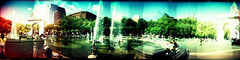 washington square park 360 (OuroborosX) Tags: park new york city people playing newyork color colour water fountain children fun holga amazing arch play washingtonsquarepark panoramic multipleexposure have fountains sprinklers liad liadcohen ouroborosx
