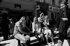 Girls were eating sushi rolls for the lunch (Erkki Heln) Tags: street girls summer bw food film sushi sticks nikon sweden stockholm eating blondes young nikkor rodinal tmax400 f4 sushirolls swerige 255040
