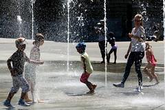 dodging the jets (overthemoon) Tags: summer people playing hot water fountain schweiz switzerland bern svizzera berne palaisfédéral bundesplatz keepingcool