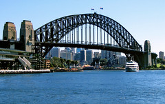 sydney harbour bridge ferry luna park water new south wales australia city 2004 circularquay sydneyharbour historic iconic sydneyharbourbridge lunapark newsouthwales restored waterscape architecture buildings tourism captaincook sydney2000 wharf6 harbourcruise commercial signs highrise northsydney cityskline cityscape philips ciscosystems agl sharp samsung restoration