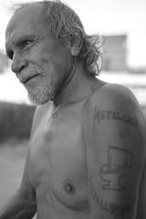 Israel - Keeping his spirits up (radargeek) Tags: oklahoma tattoo downtown homeless tattoos metallica okc oklahomacity thehumanfamily