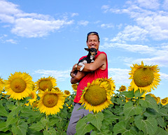 Diego's Sojourn to the Sunflowers (Colorado Sands) Tags: man male guy dog pet chihuahua sunflowers colorado sandraleidholdt usa diego flowers plant animal blossoms