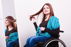 Disabled girl looking at mirror. (IWillHaveHam) Tags: girl wheelchair hairs combing beauty comb attractiveness handicap crippled mirror disabled health disease smiling self value reflection comfortable person care invalid paralysis therapy adult patient makeup joy positive teenage young poland