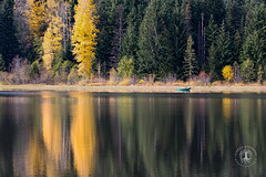 Solitary confinement (CarlaAxtmanPhotography) Tags: oregon oregonlandscapephotography oregonlandscapephotographers mthood trilliumlake fall fallcolor fallleaves boat autumn autumnleaves