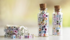 Letters in a bottle (judith511) Tags: odc three bottles beads letters