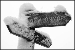 NEWTONMORE (Donald Noble) Tags: badenoch highland invernessshire newtonmore scotland wildcattrail ice monochrome sign snow timber water winter wood