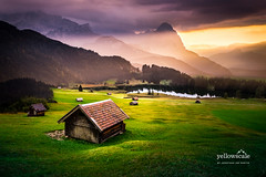 Chalets in Geroldsee (nybblr) Tags: germany europe mountains mountain peak südtirol travel sunset sunlight green orange purple southtyrol alps nature landscape clouds grass canon 24105mm wanderlust moody cliff outdoor trees mountainscape dusk chalet cabin lake water