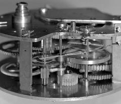 Clockwork (jsirevaag) Tags: blackandwhite motion macro film metal polaroid moving machine hasselblad hp5 clockwork armature gears ilford extensiontube filmback 110mmf28 205tcc