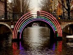 Amsterdam Rainbow Lights Canal Bridge (Gilli8888) Tags: amsterdam holland netherlands rainbow canal water boat light bridge archbridge dusk twilight reflections reflectionsinwater