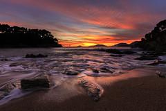 Tellaro sunset (Enrico Cusinatti) Tags: acqua water sassi rocks beach sunset tramonto cielo sky tellaro liguria enricocusinatti italia italy mare sea seascape clouds nuvole