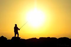 Fisherman sunrise (sergecos) Tags: leverdesoleil sunrise silhouette pêcheur fisherman soleil sun sol puestadelsol mer sea méditerranée mediterranean nikon d7000 contraste sunset ombre shadows côte littoral shore digue dam salidadelsol