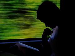 Reading in a train - La lectrice du train (Max Sat) Tags: blur book booklover colorful fuji fujixe1 fujinon green idratherbereadingalibraryofartforbooklovers lecture livre maxsat maxwellsaturnin motionblur portrait reading reder shadow silhouette train vert window woman xf60 unexplored