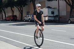 Unicycle in Mission District SF (cooli_#1) Tags: california street food men girl photography photo rainbow nikon women san francisco walks shoot outdoor district bart 85mm mexican mission trucks grocery nikkor 18 tough d3