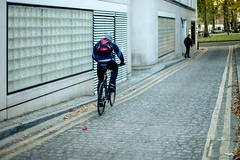 london commuter (paologmb) Tags: instagram cyclist noctilux095 delivery street commute instacool leicamtyp240 red bike travel sport backpack photography style