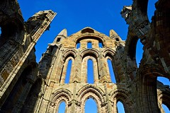 The Sanctuary (rustyruth1959) Tags: nikon nikond3200 tamron16300mm yorkshire whitby whitbyabbey abbey sanctuary eastend eastwall east wall ruins stonework windows building architecture structure sky blue outdoor 13thcentury arches arch pinnacle monastery column