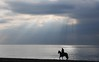Against the sunrise (Vee living life to the full) Tags: italy italian riviera leger travel touring holiday nikond300 dianodemarino rider horse morning sunrise sunray cloud water shining reflection beach silhouette sun sea sand trot canter walk man person male